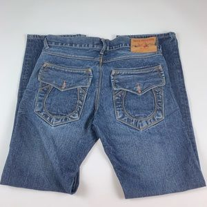 True Religion blue jeans no back pocket buttons